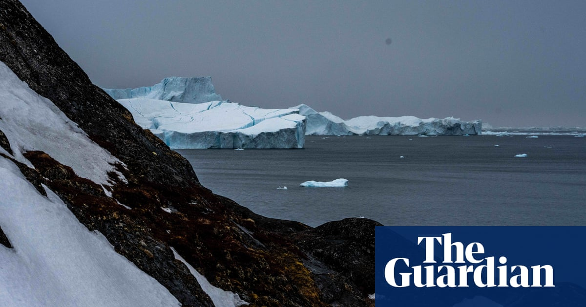 Rain falls on peak of Greenland ice cap for first time on record