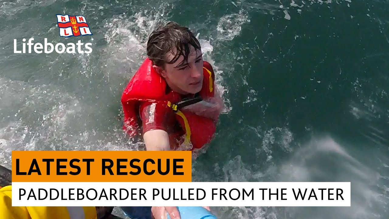 Intense video of a paddleboarder saved by his lifejacket and waterproof phone pouch